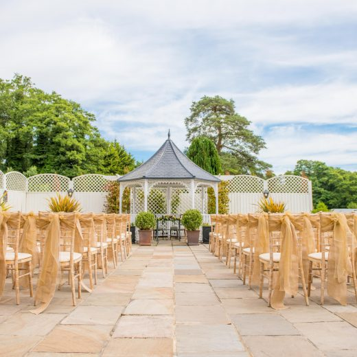 chair set up and wedding pergola at outside chichester wedding venue