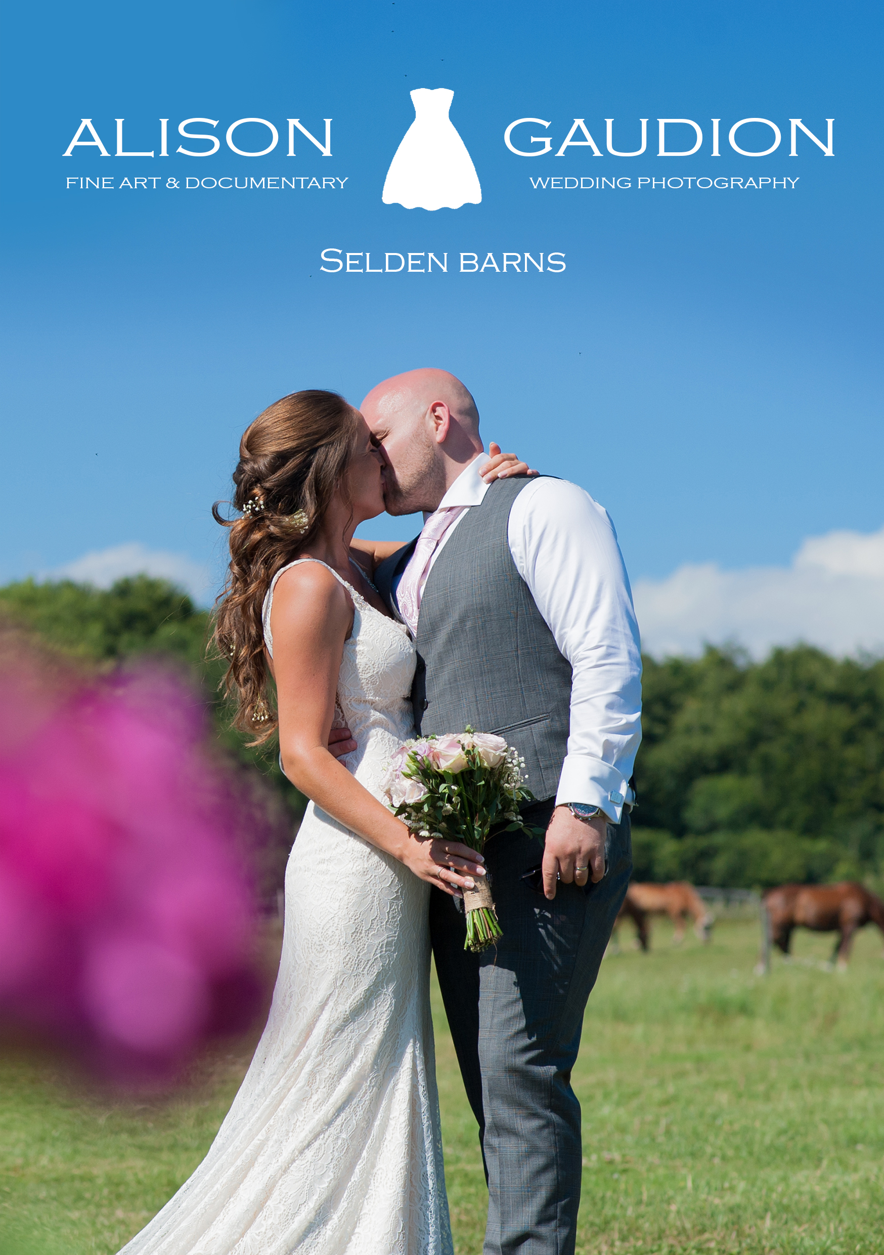 bride and groom kissing outside in field with horses at selden barns by ali gaudion