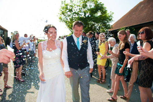 confetti walk romantic couples shots in the roses at selden barns wedding venue west sussex