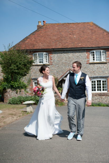 walking romantic couples shots in the roses at selden barns wedding venue west sussex