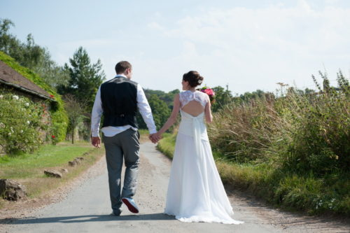 romantic couples shots in the roses at selden barns wedding venue west sussex walking couple