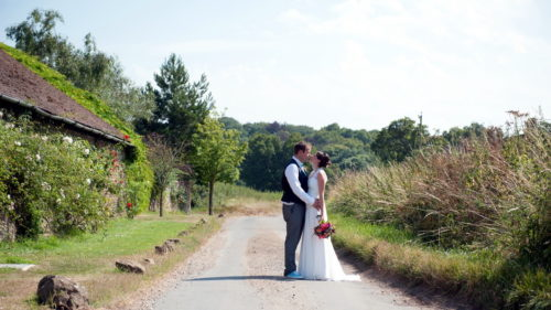 bridal couple walking down the lane at Selden Barns Lane Sussex