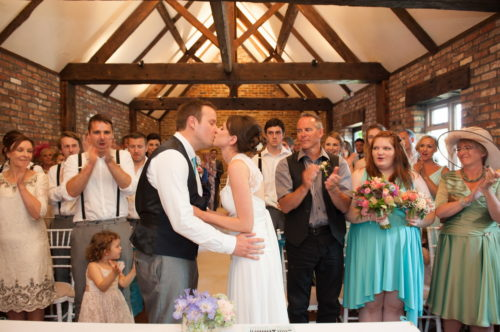 first kiss romantic couples shots in the roses at selden barns wedding venue west sussex