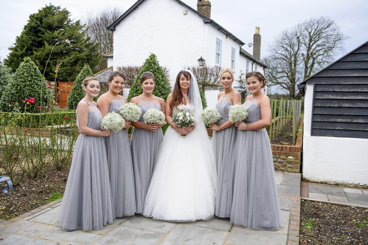 wedding day photography of a bride and her bridesmaids in chichester